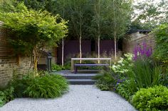"John Davies - Contractor Hortus Build. This long and narrow garden is nicely ""shortened"" by rising the level towards the end of the garden."