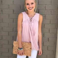 This blushing draped, tie front top is gorgeous paired with white denim for the summer! It's available in store/online or call to order! #shopatl #atlantaboutique #shopsmall #shoplocal #stayHIP #handinpocket #springtrends #ootd #outfitinspiration #tiefronttop #whitejeansoutfit #corkclutch #fauxwraptop #flirty #summeroutfit