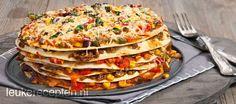 Super leuk Mexicaans recept van tortilla, groenten en gehakt opgestapeld tot een taart, ook leuk voor de kids!