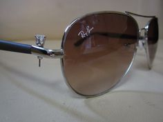QUICK FIX!! When the pin from the hinge on your sunglasses goes missing. Take out your earring and pop it in the place of the pin. It will hold until you can get them fixed!