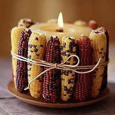 Large candle with Indian corn and hemp cord. Very easy decoration for fall.