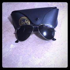 Ray-Ban polarized aviators **WILL TRADE FOR BLACK POLARIZED WAYFARERS WITH COMPLETELY BLACK LENSES!!** Silver frame with black lenses. Polarized. Worn twice. Comes with cleaning cloth and case.no scratches. Ray-Ban Accessories Sunglasses