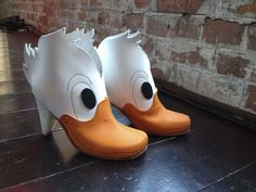 Duck Martens. :D Finnish designer Lotta Astrid (Lotta Löfgren) made third place in the Award for the Crazy Shoe 2012 design contest in Vienna with these! Awesome!