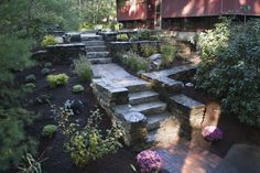 Artistic Landscapes: Pavers, Segmental Wall and Natural Stone Masonry