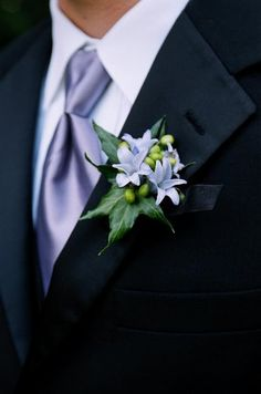 Iris or lilac boutonniere and tie