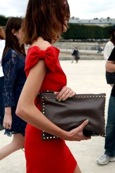 Bow shoulders? Yes please. Border studded leather clutch? Yes please.