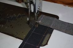 Starting the careful and meticulous interlacing of the #selvedge #handloom #denim fabric.  Exclusive Hand-stitched Cushion Cover in the making..... This cushion cover is made from eco-friendly handloom denim, and is completely hand-stitched on a foot pedal operated vintage sewing machine, by a seasoned tailor.  The chess-board design, made by interlacing strips of denim fabric, is an ever-green design, and has a mesmerizing effect.  The darker color is the face of the fabric, and the light