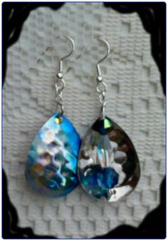 http://diginanchors.com/EarringsAlure_BlueBird - These Dangle Earrings are crafted from Fishing Lures that are made from high grade carbon steel and then painted with the beautiful blue stripe and silver colors. We add the sparkling sky blue Crystal Beads along with  clear Crystal to create our Custom Beaded earrings.  The Handmade Beaded Jewelry is hung on surgical stainless steel earwires or silver plated brass clip-on, leverback with 5mm half round and adjustable screwback.