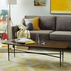"""West Elm Slim Coffee Table $299 54 * 19.  """"Engineered"""" wood top.  Longer & narrower than most.  Has significantly more square inches than Gibson & Stafford by Room & Board (1026 for slim vs. about 930 for R&Bs). Pleasing table, but I don't like the dark brown wood with my grey sofas."""