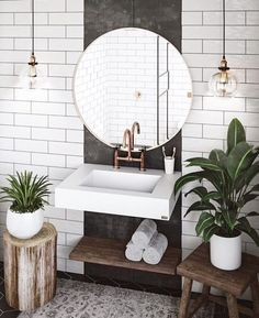 Modern Scandinavian bathroom with wooden interior and green plants.