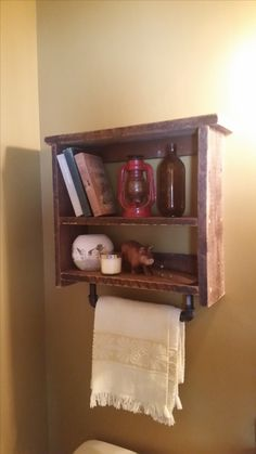 My little Sunday project to spruce up the mudroom guest bath. Bathroom Shelf made with ..reclaimed lumber from Vanier Ontario home and metal pipes from Lowes