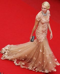 Chiffon chic: Naomi Watts is a study in understated elegance in a Marchesa dress covered with feather-studded bodice and cascading chiffon skirt