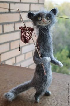 Cute face on this needle felted cat by Olya and Dasha from Russia