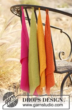 """Knitted DROPS towels in different textured patterns in """"Safran""""."""