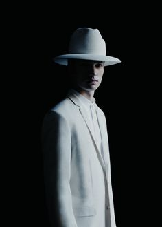 "Dior Homme releases its latest ""Les Essentiels"" collection featuring the iconic wide-brimmed hat, trench coats, jackets and T-shirts."