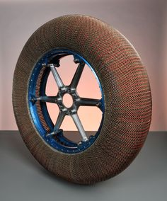 Future lunar vehicles might use a lunar spring tire made from wire mesh like this to move across the Moon. Mesh tires were also used on the rovers during the later Apollo missions in the early 1970s. This was a gift of The Goodyear Tire and Rubber Company. (c) AMNH/D. Finnin