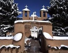 Taos, NM.  My first visit to Taos was on a day just like this photo, in January 1976, with a bright blue sky and snow covering the ground.