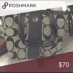 """COACH Signature Tote F21950 BARELY USED ONLY LITTLE WEAR ON STRAPS •Style F21950 •Wrapped in Coach's dual tone black and gray Signature C printed fabric with black trim and silver tone hardware.  •Fabric specially treated to be water repellent. Signature fabric with patent leather trim •Lined interior, zippered pocket, two multifunctional slip pockets. •Back has full length slip pocket  •Fully zippered top Leather top handle with approx. 8"""" drop •two authentic Coach leather embossed hang…"""