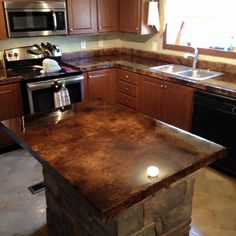 Ken's Custom Designs - Beautiful Acid Stained Overlay on Kitchen Countertop Remodel. Coffee Brown Acid Stain on Concrete Overlay Sealed with 100% Epoxy Countertop Sealer.