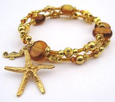 Beaded Memory Wire Bracelet with Seahorse Charm by AquariCreations on Etsy $50.00