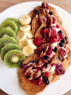 """tobefre-ed: """"Vegan protein pancakes with soy yogurt, mixed berries, almond butter, a banana and a kiwi! """""""