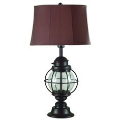 Bring some elegance and luxury to your home with this indoor/outdoor table lamp. Constructed from metal with a gilded copper finish, this table lamp is built for long-lasting durability. The shade on this lamp is highlighted with a soft chocolate color.