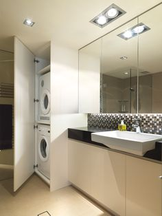 small bathroom with laundry inside cabinet