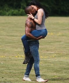 Interracial Passionate Kiss... Girl lifted as couple share a passionate kiss