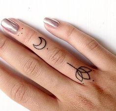 Minimal geometric and dotwork finger design by @ann_pokes