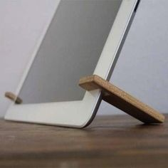 DIY Wood iPad Stand - The simplest and most portable of the bunch, this stand consists of two wood arms that slip over the sides of the tablet. Glue a magnet to each arm so that when traveling, you can easily keep the stand paired with your iPad.