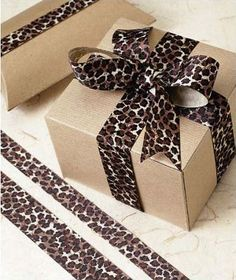 Grosgrain Leopard Ribbon, 1 This eco-friendly ribbon is not only beautiful, it's non-toxic and uses water-soluble dyes. Creative Gift Wrapping, Present Wrapping, Creative Gifts, Wrapping Ideas, Holiday Gifts, Christmas Gifts, Christmas Decorations, Safari Chic, Gift Wrapper