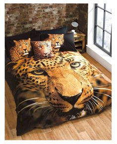 Double Duvet Cover and Pillowcase Set features a stunning photographic image of a leopard.