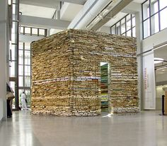 How wonderful would it be to have a reading room made from books? Czech Artist Matej Kren creates ambitious structures using old books destined for the landfill. He's been designing bookish sculptures since 1995, some of which are permanent installations housed in libraries. The outer fascades of many of the installations feature the foredges of the books, in lieu of the spines.