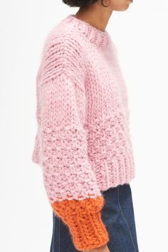 Product Details:The cropped, fitted Zip Zap jumper is made by hand, using natures woolly gifts. Because wool is a natural resource and