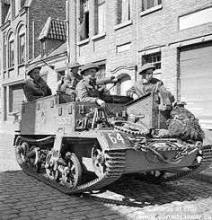 Belgium - Infantrymen of the Toronto Scottish Regiment in their Universal Carrier waiting to move forward. September 9, 1944, Nieuport, Belgium.