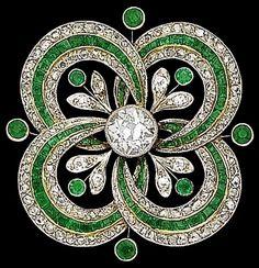 Emerald and diamond pendant / brooch, ca.1915.