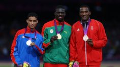 Silver medallist Luguelin Santos of Dominican Republic, gold medallist Kirani James of Grenada and bronze medallist Lalonde Gordon of Trinidad and Tobago pose on the podium during the Victory ceremony for the Men's 400m on Day 11 of the London 2012 Olympic Games at Olympic Stadium
