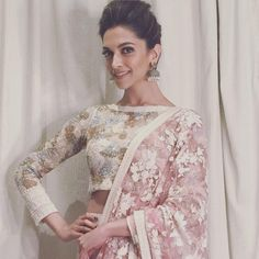 Nothing can beat a woman's beauty in a saree with matching blouse. Here are 50 latest and beautiful saree blouse designs that are suitable for every woman. Blouse Back Neck Designs, Netted Blouse Designs, Latest Saree Blouse, Latest Sarees, High Neck Saree Blouse, Sari Bluse, Deepika Padukone Style, Deepika Padukone Lehenga, Sonam Kapoor