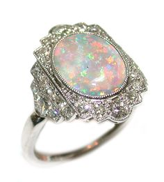 """The opal is a symbol of hope, fidelity and purity. The ancient Romans named it the """"Queen of Gems"""" – for it captures the colors of all other gems. I have the opal. Bijoux Art Deco, Art Deco Jewelry, Opal Jewelry, Jewelry Rings, Jewelry Accessories, Fine Jewelry, Jewelry Design, Jewellery Box, Jewlery"""