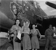 Lovely Ann Sheridan (center) with volunteers for a WWII USO tour standing at the nose of a B-25 named for her.