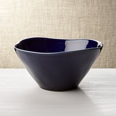 Our most coveted casual dinnerware collection recalls the warm hospitality of Portugal's quaint seaside cafes. Glazed deep Mediterranean blue, each free-form stoneware cereal bowl is hand-antiqued at the rim by Portuguese artisans.