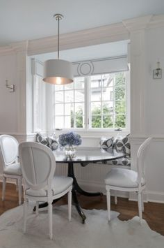 Nook. Don't have a bay window but could create the illusion by flanking seat with cabinets?