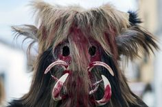 """A Carantona poses during the Carantonas festival in Acehuche near Caceres, Spain, on January 21. The """"Carantonas"""", monster-animal characters mixing paganism with Christianity, search for Saint Sebastian in the streets of the village of Acehuche, southwestern Estremadure province, dressed in patchwork sheep, cow, rabbit and goatskins under painted masks. Arriving eventually at the village church, a procession takes place with the statue of the patron saint."""