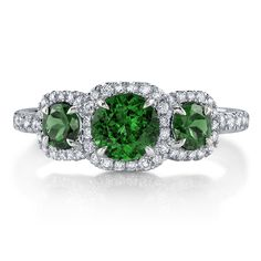 Our latest #Emerald addition - this beautiful three stone #ring holds vibrant Emeralds surrounded by bright #Diamond halos!  Definitely a must try-on!