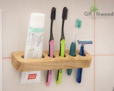 ▬ Click + More for more product details This handmade holder attached to the wall with two scerws, so you can securely fix it and be sure that your brushes will never drop down to the floor. As it usually happening with toothbrush cups. Brushes are rested Toothbrush And Toothpaste Holder, Toothbrush Storage, Wall Mounted Toothbrush Holder, Toothbrush Organization, Bois Diy, Jewelry Armoire, Handmade Wooden, Woodworking Plans, Woodworking Classes