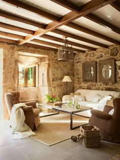 Rustic Chic Living Room. Love the Rustic walls & Beams in contrast to the chic refined upholstery,coffee table & area rug  Verdigris Vie: Lugar do Cotariño, Spain