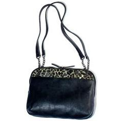 "Leopard Print Trim Shoulder Bag Chic, leatherlike shoulder bag with a glam leopard-print trim. Double-zip closure. One zip and two slip pockets inside. 9"" H x 12"" W x 3 1/2"" D. Handle drop, 15"". Fully lined"