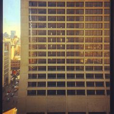 Looking into the windows of the once grand Carlton Hotel empty now for 20 years. I wonder what it's like inside and with the revival of the CBD why the owners don't use it - even just as apartments... #Carlton #carltonhotel #joburg #johannesburg #modernism #brutalism #modernistarchitecture #emptyhotels #abandonedbuilding #downtown by delaneyartist