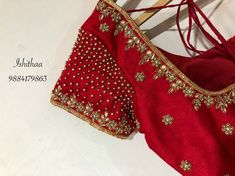 Cluster of beads right on bride's sleeves. Beautiful red color designer blouse with floret lata design hand embroidery gold thread and bead work. Simple Blouse Designs, Stylish Blouse Design, Bridal Blouse Designs, Blouse Neck Designs, Stone Work Blouse, Maggam Work Designs, Pattu Saree Blouse Designs, Designer Blouse Patterns, Kurti Designs Party Wear