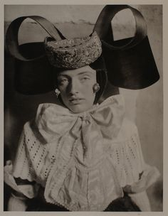 This hat is even better for you! Especially with that collar bow!! It's you heritage!!! LOL!!! Bückeburg, Germany 1930